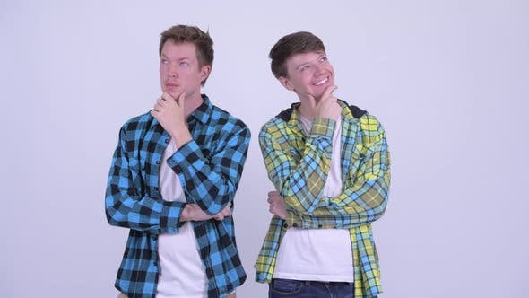 Cover Image for Two Happy Young Handsome Men Thinking Together