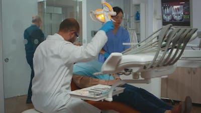 Dentist Technician Preparing for Surgery Lighting the Lamp