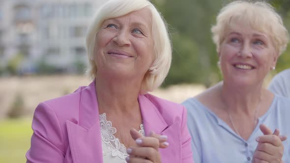 Thumbnail for Two Positive Senior Women Clapping Their Hands and Looking at Something. Nice Middle-aged Females