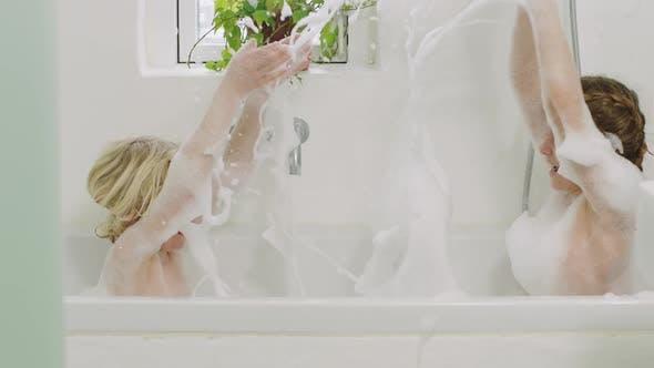 Thumbnail for Kids Splashing Soap Suds In Bath