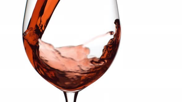 Thumbnail for Slow motion shot of red wine pouring into glass on white background; shot on Phantom Flex 4K at 1000