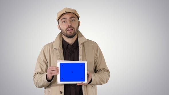 Thumbnail for Man in Trench Walking and Holding Tablet with Blue Screen