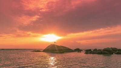 Sea Stones at Colorful Sunset and Beautiful Cloudscape