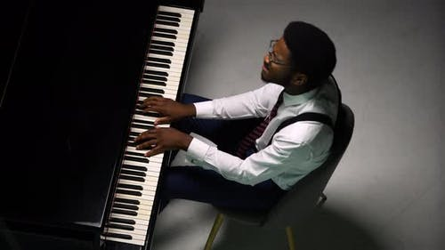 Top View of Stylish Man Playing Grand Piano