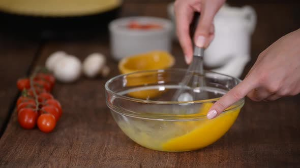 Thumbnail for Close up woman hand beat eggs in kitchen.