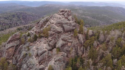 Aerial Shot of Tourists Climb To the Top of the Rock in the Siberian Natural Park Stolby