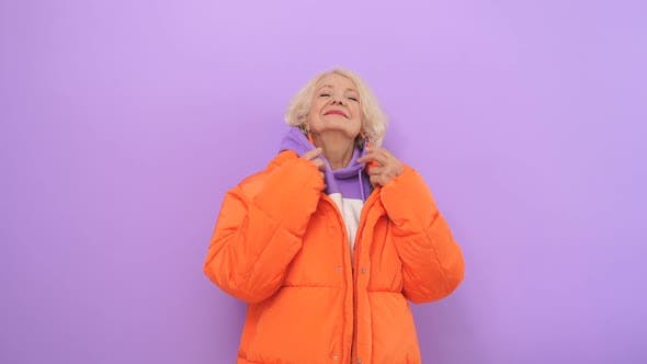 Cheerful Old Lady Happy with Life Posing for the Camera in the Studio on an Isolated Background