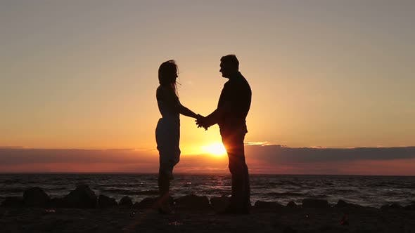 Thumbnail for Happy Couple Holding Hands on Beach at Sunset