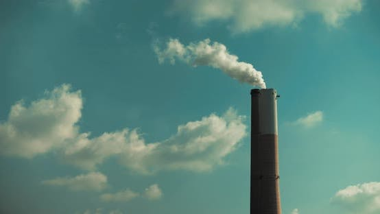 Thumbnail for Time lapse of a smoke coming out of a power plant chimney, clouds and blue sky