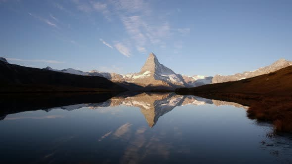 Picturesque View of Matterhorn Peak and Stellisee Lake in Swiss Alps