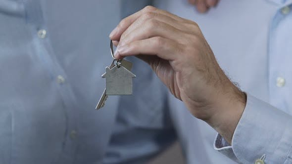 Thumbnail for Family Showing Keys from New Apartment, Family Loan Fund, Affordable Housing