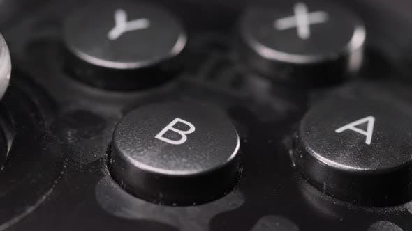 Modern Gamepad on a Dark. Game Controller