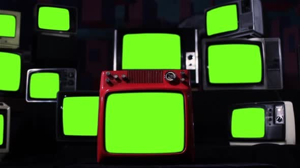 Stack of Old TV turning on Green Screens. Iron Tone.