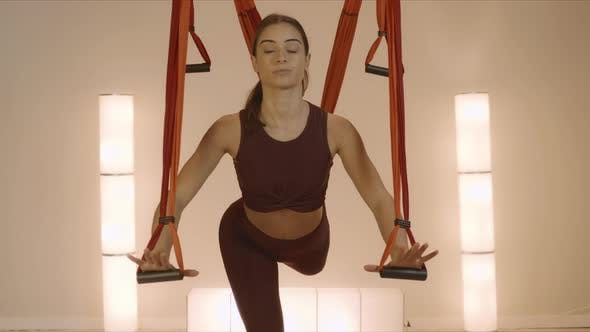 Thumbnail for Woman Practicing Yoga with Straps in Studio. Serious Lady Training Indoors