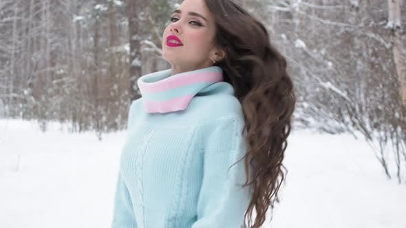 Cover Image for Stylish Young Woman Walking Towards Winter Forest