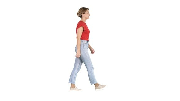 Thumbnail for Woman in red t-shirt jeans and sneakers walking on white