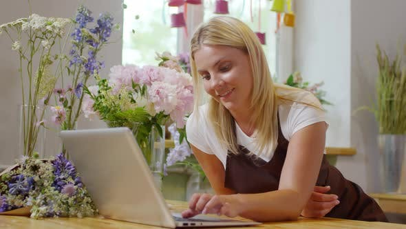 Cover Image for Young Blonde Florist Working on Laptop