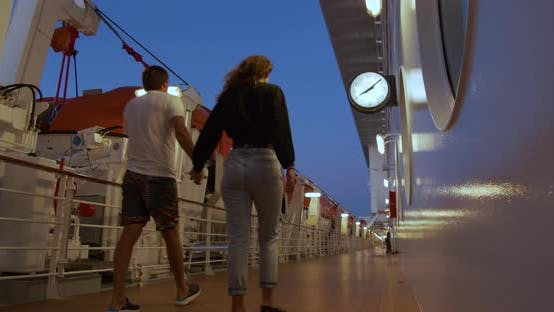 Thumbnail for Couple Strolling on Deck on Cruise Ship in the Evening.