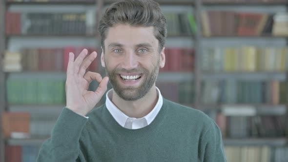Thumbnail for Cheerful Young Man Showing Ok Sign