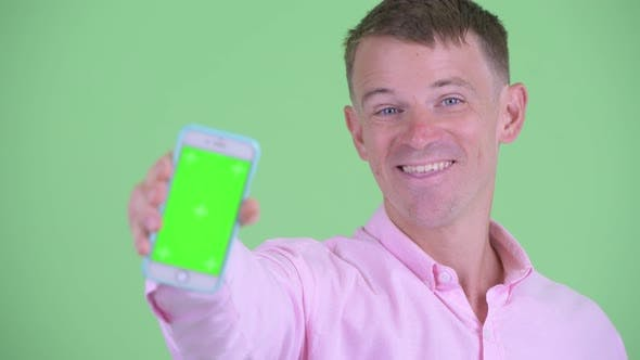Thumbnail for Face of Happy Businessman Showing Phone