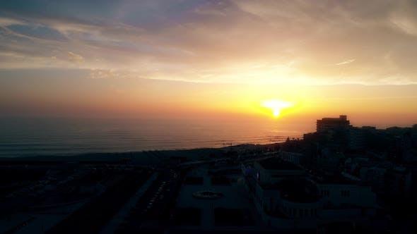Thumbnail for Coastal City at Sunset