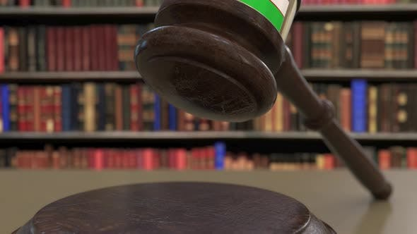 Flag of Uzbekistan on Falling Judges Gavel in Court
