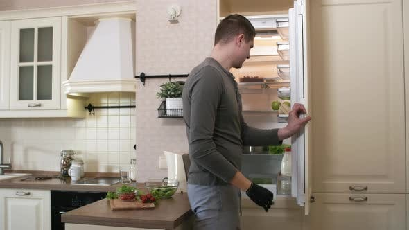 Thumbnail for Caucasian Man with Prosthetic Forearm Taking Food out of Fridge