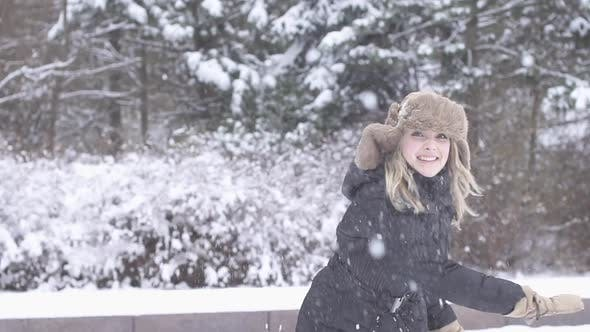 Thumbnail for Beautiful Young Female Troughing Snow Ball and Laughing