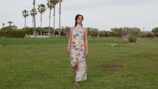 Model with long white dress with flowers