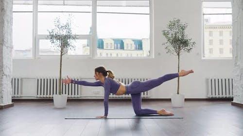 Yogi Woman in Balancing Table Pose