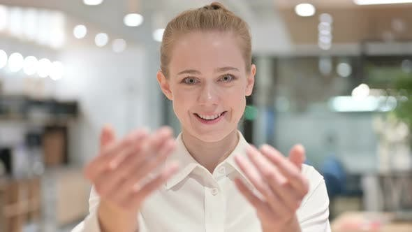 Thumbnail for Happy Businesswoman Pointing with Finger and Inviting