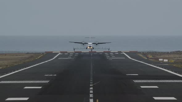 Thumbnail for An Airport Runway with a Landing Plane