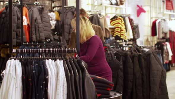 Thumbnail for Girl Helps To Choose Clothes for Her Boyfriend in the Store