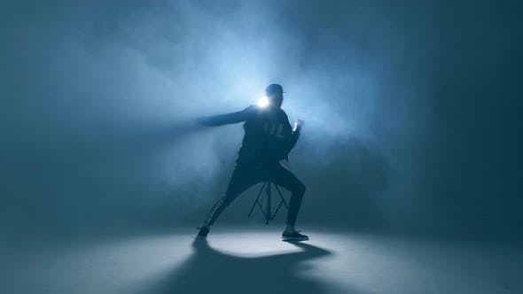 Thumbnail for Sporty Modern Style Hip-hop Dancer Shows His Dance on Blue Studio Background.