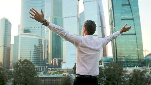 Thumbnail for Back View of Businessman Looking on Copy Space While Standing Against Glass Skyscraper