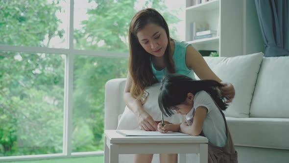 An Asian Mother Teaching Her Daughter at Home 02