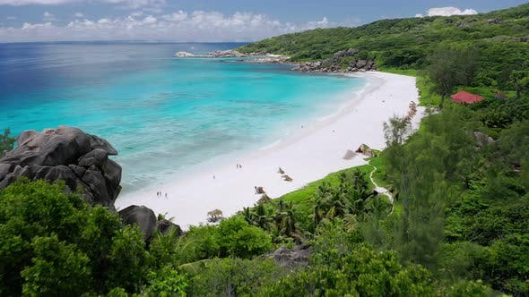 Thumbnail for Aerial Fly Over White Sand Grand Anse Beach. Crystal Clear Turquoise Blue Ocean Lagoon. La Digue