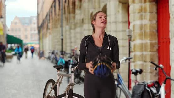 Thumbnail for Sportive woman bicyclist using smartwatch outside