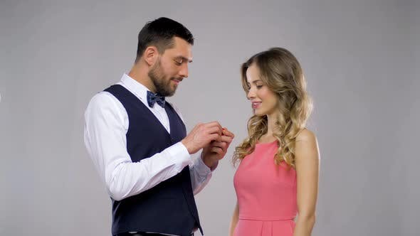 Happy Man Giving Engagement Ring To Woman 4