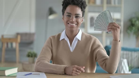 Thumbnail for Excited African Girl Showing Money And Smiling