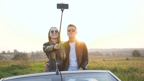 Thumbnail for Beautiful Caucasian Couple Taking Selfie While Sitting in the Cabriolet