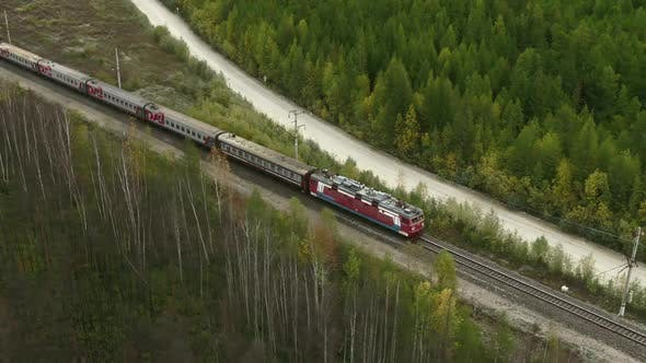 Thumbnail for A Train Is Going Through the Forests in Russia