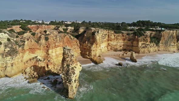 Cover Image for Aerial View on Rock and Waves in Algarve Portugal