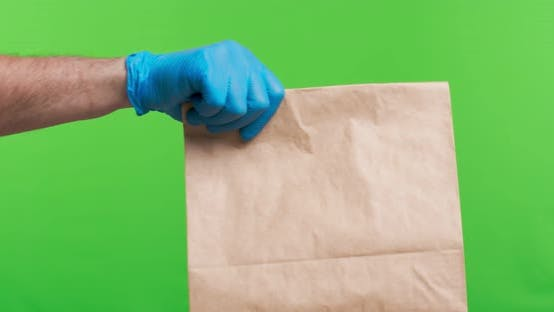 Thumbnail for Courier Giving Parcel To Female Client, Both in Protective Gloves