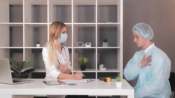 Thumbnail for Doctor Picks Up the Pills and Gives Them To the Patient. The Doctor Takes One Blue Capsule From the