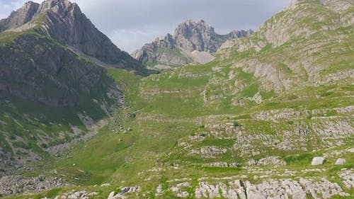 Young Couple Hiking in Trail Leading to Kleine Scheidegg From Mannlichen with Eiger Monch and