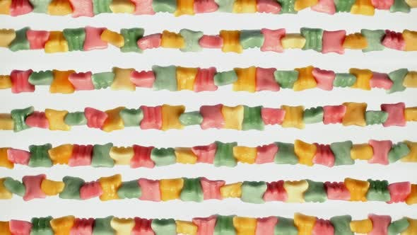 Cover Image for Lot of watered multi-colored sweets, juicy colored chewing marmalade rotates on white background