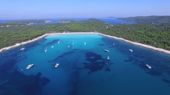Flying over yachts and sailing boats at a Dalmatian bay