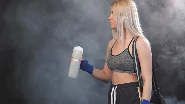 Blonde Sportswoman Going To Gym with Bag and Shaker for Gym. Sports Lifestyle