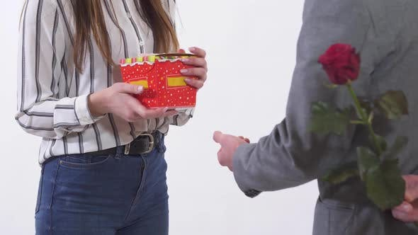 Thumbnail for Unrecognized Man and Woman on a Date, Man Give Present and Red Rose for Woman